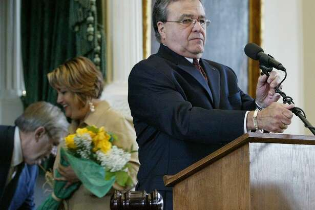 Sen. Frank Madla, D-San Antonio, right, prepares to deliver his acceptance speech after being sworn in as President Pro Tempore of the Texas Senate Monday, May 30, 2005, in Austin. He was the driving force behind the creation of Texas A&M University San Antonio.
