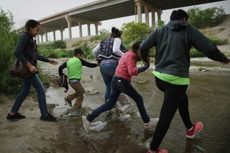 Migrants make their way to cross the border between the U.S. and Mexico at the Rio Grande river, on their way to enter El Paso, Texas, on May 20, 2019 as taken from Ciudad Juarez, Mexico. The location is in an area where migrants frequently turn themselves in and ask for asylum in the U.S. after crossing the border. Approximately 1,000 migrants per day are being released by authorities in the El Paso sector of the U.S.-Mexico border amidst a surge in asylum seekers arriving at the Southern border.