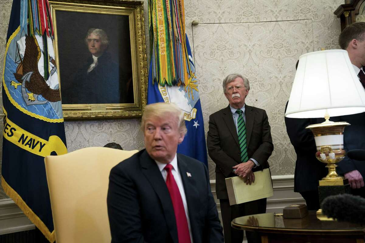 John Bolton, then the new national security adviser, stands by during a meeting between President Trump and the Secretary General of NATO in the Cabinet Room, at the White House in Washington, May 17, 2018. A reader does not understand why Bolton and Trump, who avoided serving in Vietnam, seem to be pushing for war with Iran.