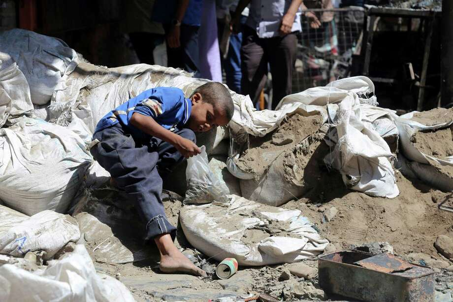 A Yemeni boy looks for bullet casings, to sell as scrap metal, in a street in an old market on April 27, 2019, in Yemen's third city of Taiz after clashes between pro-government militias left two children dead. The U.S. must withhold military supplies from Saudi Arabia to end this conflict, which has become a humanitarian crisis. Photo: AHMAD AL-BASHA /AFP /Getty Images / AFP or licensors