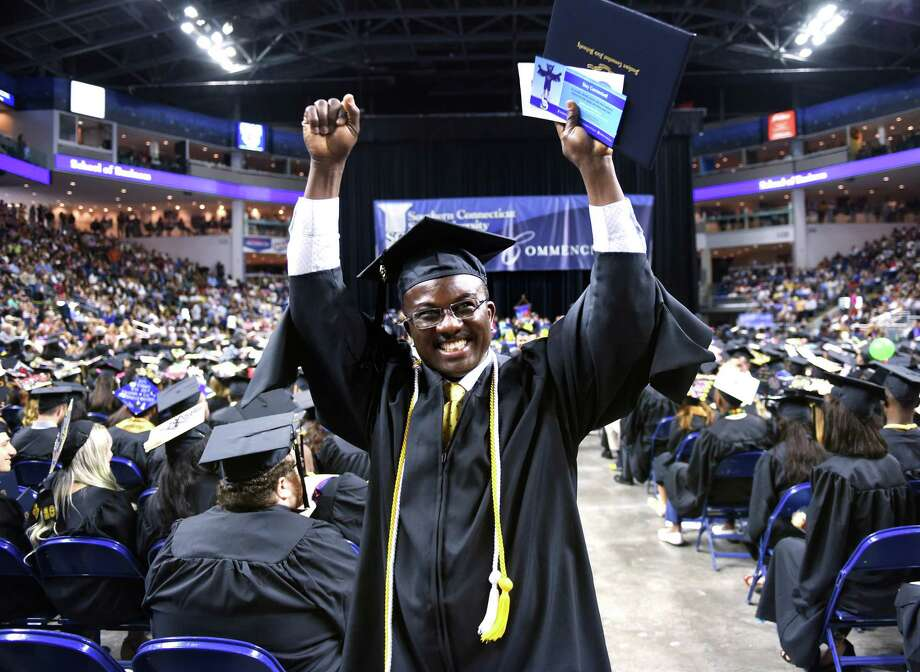 Charles Okang celebrates after receiving his Bachelor of Science degree at the Southern Connecticut State University Undergraduate Commencement at Webster Bank Arena in Bridgeport Friday. Photo: Arnold Gold / Hearst Connecticut Media / New Haven Register