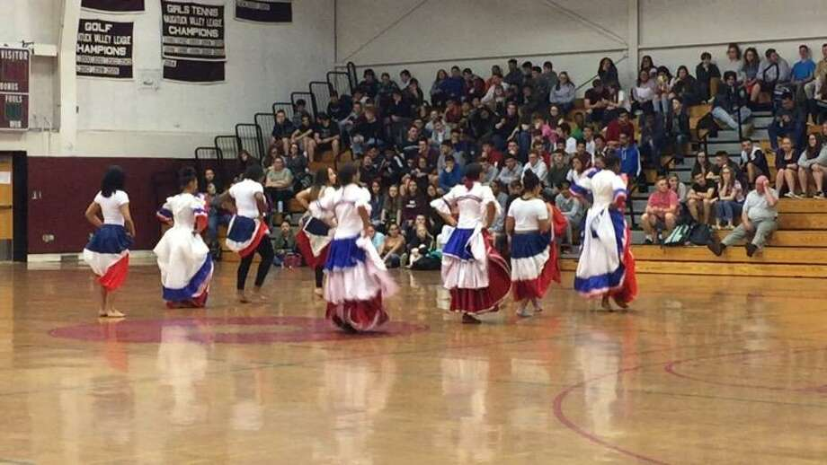Torrington High School students held their annual Diversity Day in the gym on May 23. Above, a group of students dance during the program. Photo: Elena Sileo, Mary Morton / Contributed Photo /
