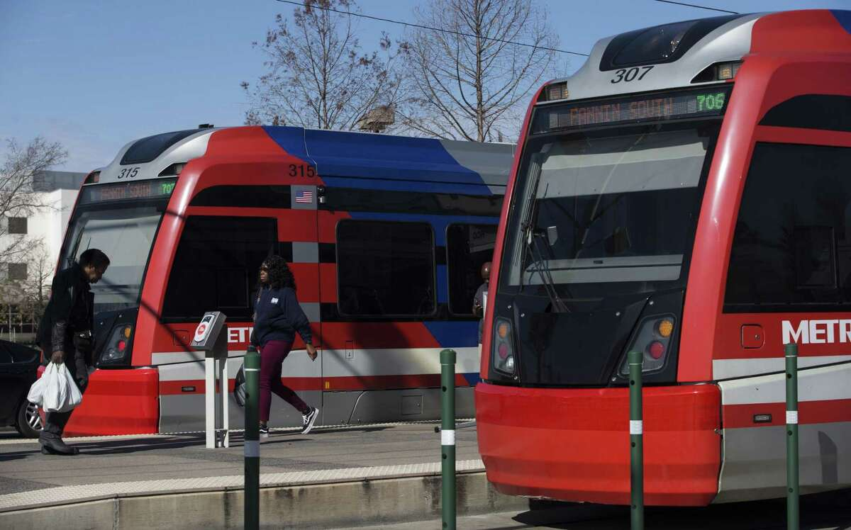 Passengers enter and exit a Metropolitan Transit Authority Red Line train at Houston Community College Northline Campus on Jan. 10, 2019, in Houston.
