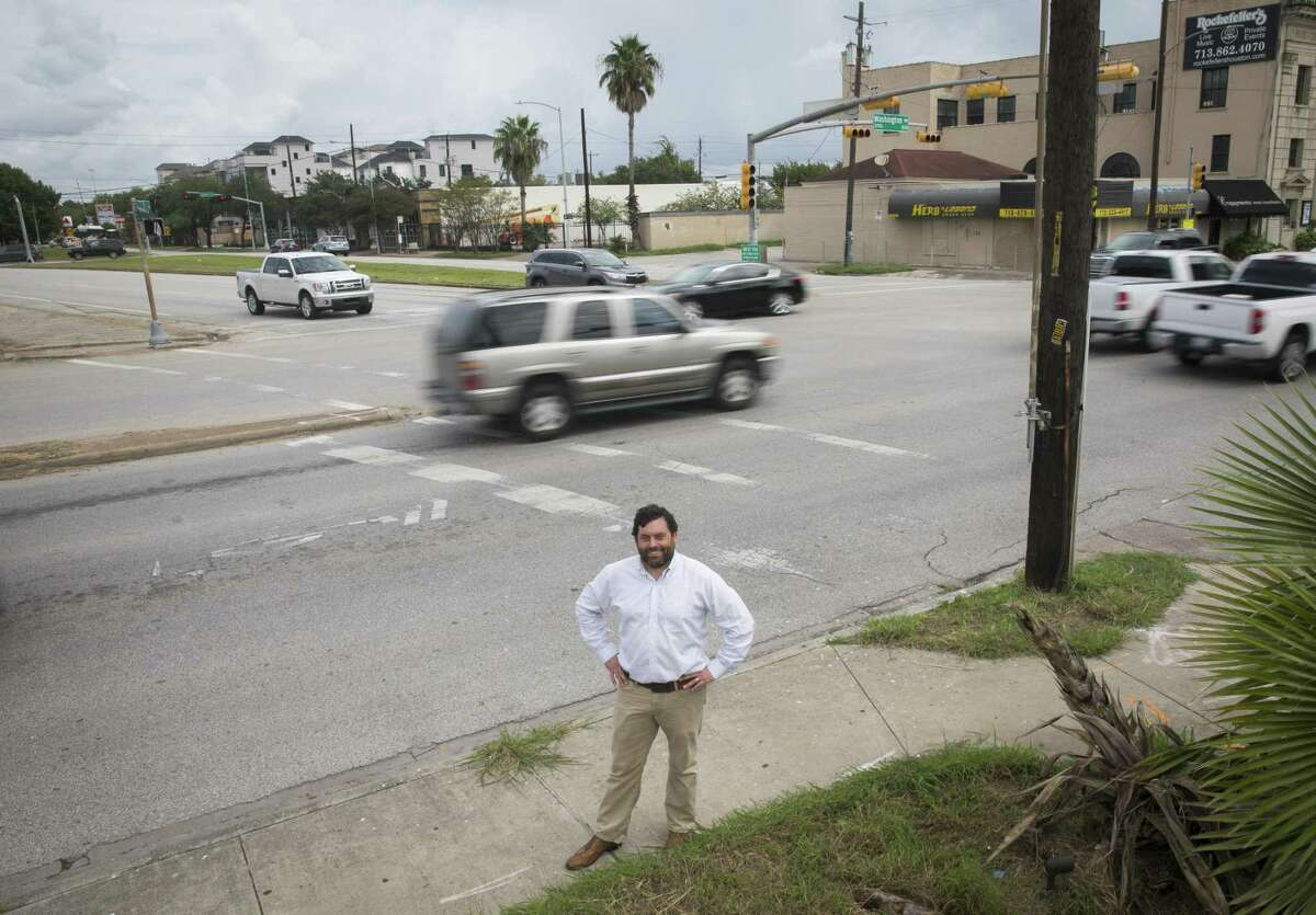 Jay Crossley, who has advocated for design changes to many Houston streets and for greater rail investment, poses at the intersection of Washington and Heights on Sept. 21, 2018.