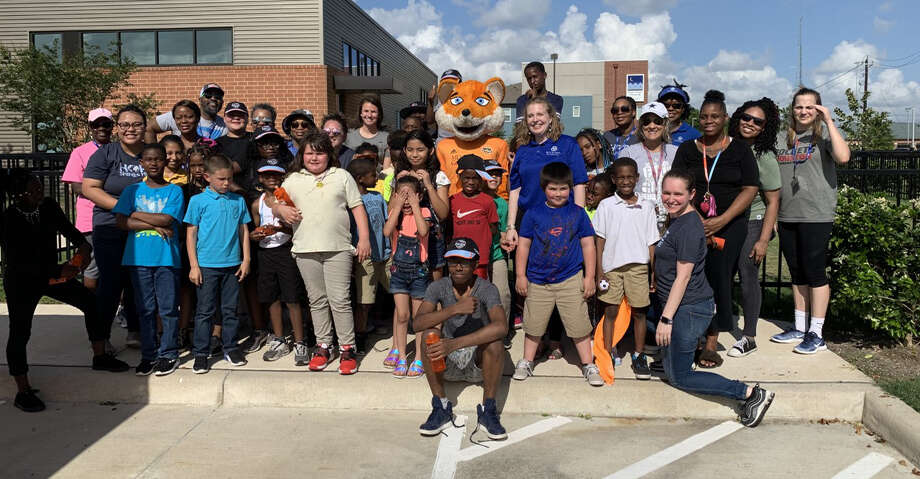CeCe Kizer and Dash/Dynamo mascot Diesel visited kids at a field day put on by Buckner International on Friday. Photo: Courtesy Of Buckner International