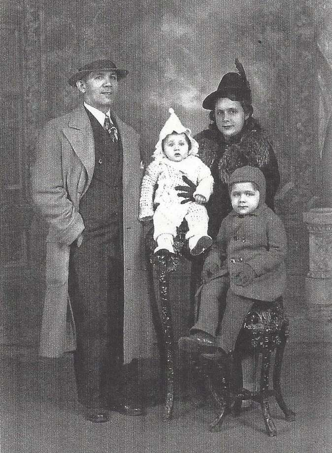 This photo was taken shortly after Juan Negroni, seated, arrived in New York City from Cuba with his mother and baby brother. They were reunited with his father and lived in Spanish Harlem. Photo: / Contributed Photo