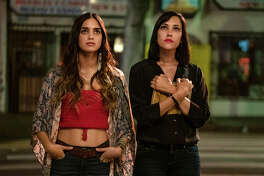 """This image released by Starz shows Melissa Barrera, left, and Mishel Prada from the series """"Vida,"""" a drama that follows two Mexican American sisters battling gentrification and the aftermath of their mother?s death. (Kat Marcinowski/Starz via AP)"""