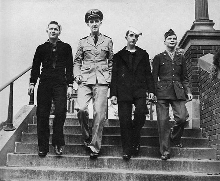 John J. Marcil, John F. McGrath, Howard D. McAlonie and Alfred E. Mahoney are photographed wearing their military uniforms on the steps of Catholic Central High School off 8th Street in Troy, N.Y. The photo was printed in the Catholicon yearbook. McGrath's aircraft went down off the coast of Japan during World War II and he is listed as missing in action.