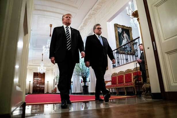 President Donald Trump and Attorney General William Barr arrive for a ceremony in the East Room at the White House on Wednesday.