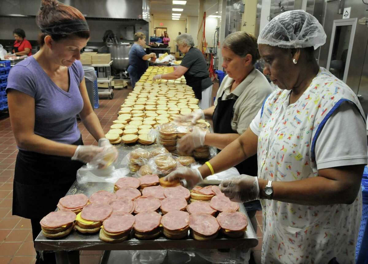 New Haven Public Schools food service workers prepare 6,000 lunches to be served for New Haven's children's summer programs.