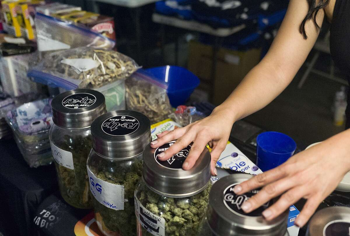"""Bags of psilocybin mushrooms, left, are seen displayed at a pop-up cannabis market in Los Angeles on Monday, May 6, 2019. Voters decide this week whether Denver will become the first U.S. city to decriminalize the use of psilocybin, the psychedelic substance in """"magic mushrooms."""" (AP Photo/Richard Vogel)"""