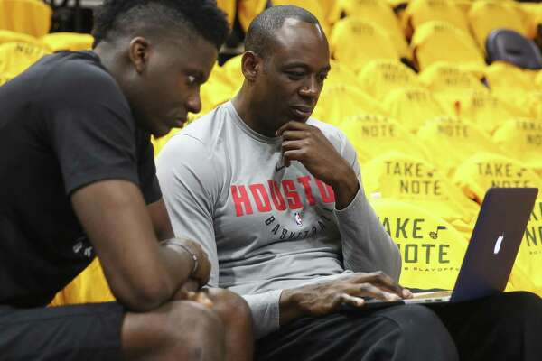 Assistant coach Roy Rogers, right, is among four members of the Rockets' staff who have been told they will be back with the team next season.