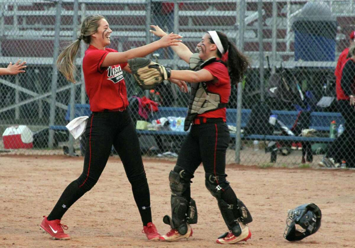Masuk pitcher Samantha Schiebe (5) and catcher Montana Killoran (25), right, celebrate after beating Notre Dame-Fairfield in SWC championship softball action in Stratford, Conn., on Friday May 24, 2019.