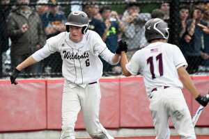 Bethel's Cole Strang scores on a wild pitch in the SWC championship game at Pender Field, Stratford on Friday, May 24, 2019. (Pete Paguaga, Hearst Connecticut Media)