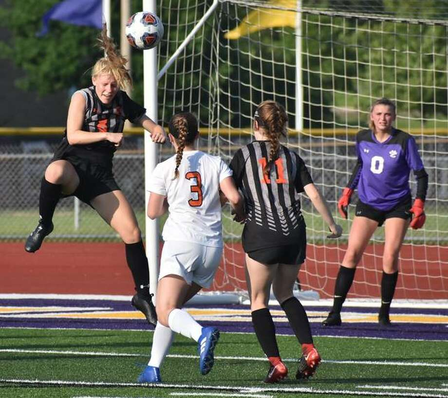 Edwardsville's Sarah Kraus, left, goes up for a head ball near the 18-yard box on Friday in Bloomington. Photo: Matt Kamp/The Intelligencer