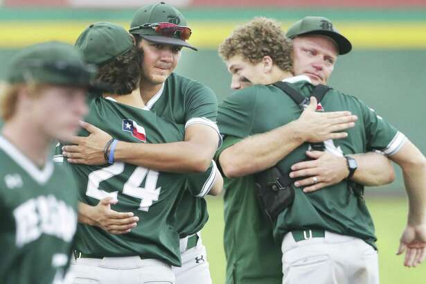 Rattler seniors Cal Martin, center, and Alec Caven, right center, get hugs from teammates and coach Chans Chapman as Reagan loses to Alexander 8-9 in game 2 of the Class 6A Regional Semifinals at Cabaniss Field in Corpus Christi on May 24, 2019.