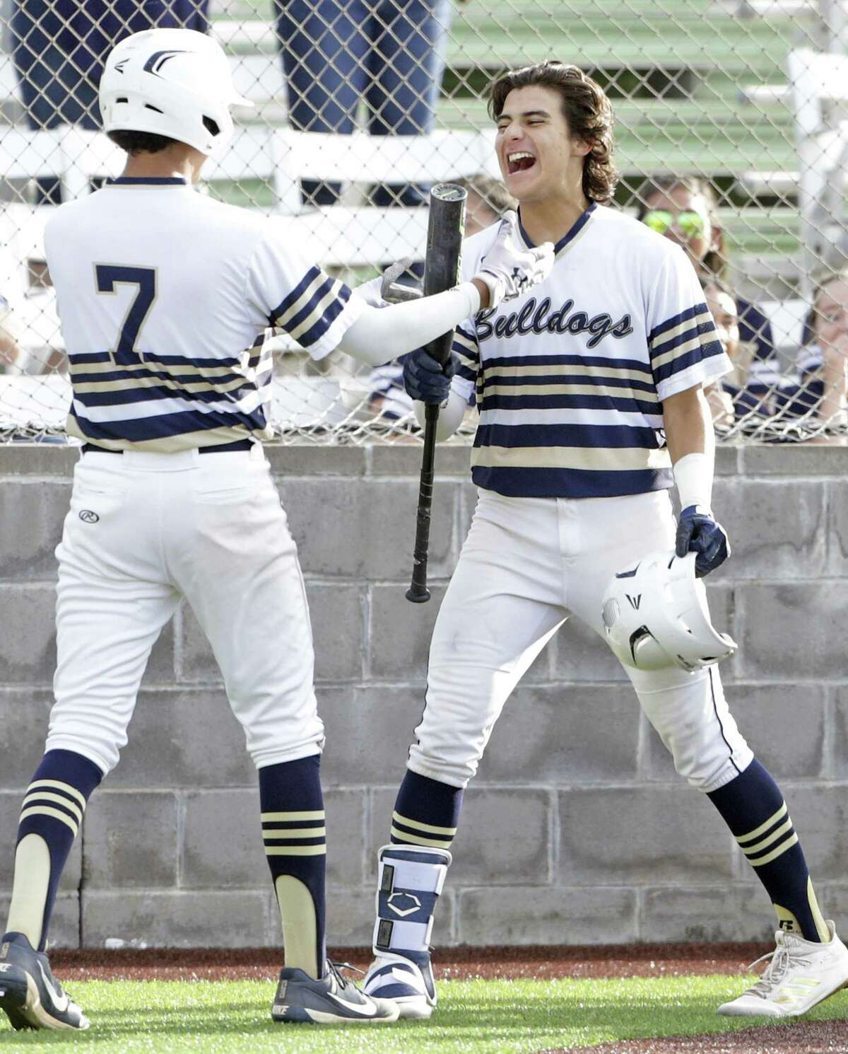 Normar Garcia, right, celebrates his two run homer in the fourth inning as the bats come alive for the Bulldogs who beat Reagan 9-8 in game 2 of the Class 6A Regional Semifinals at Cabaniss Field in Corpus Christi on May 24, 2019.