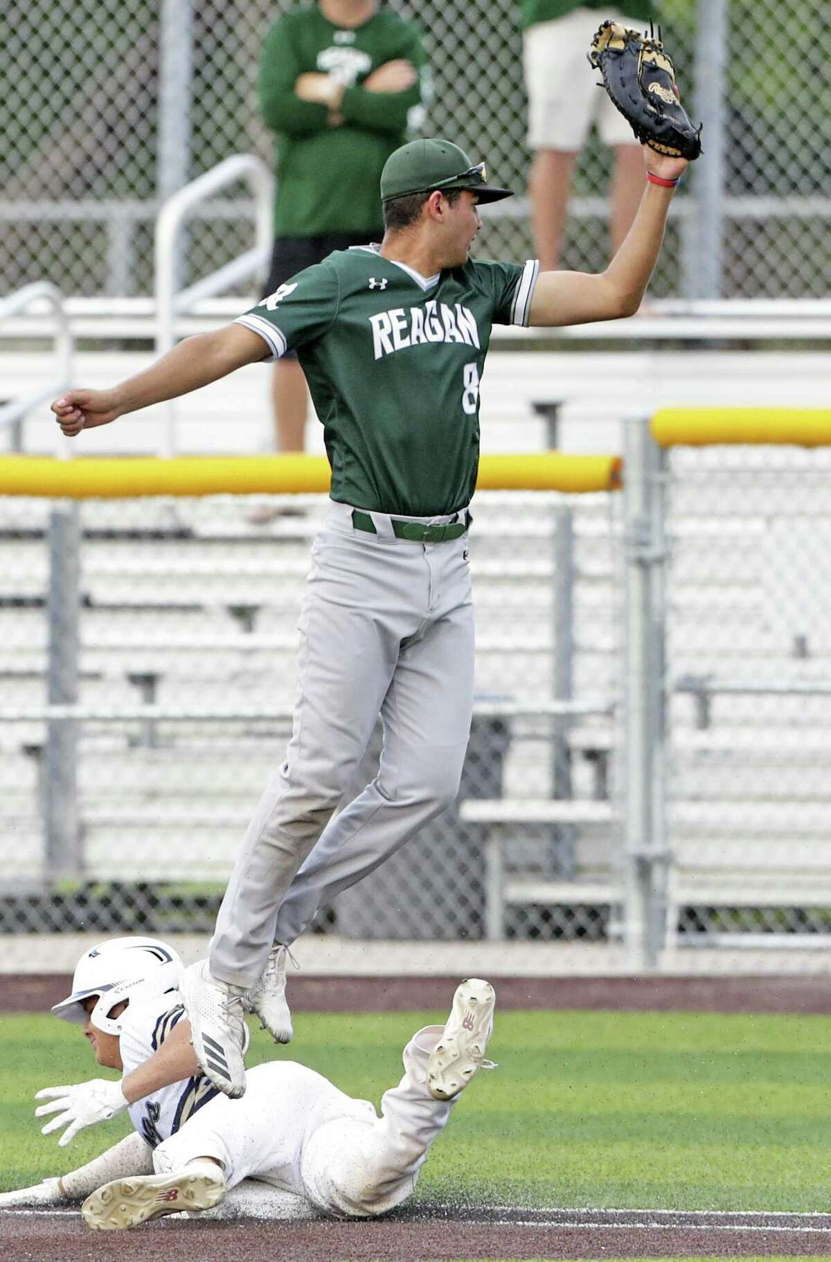 Rattler first baseman Cal Martin goes high but can only watch as a the throw from second gets away and allows the winning run in the last play of the game as Reagan plays Alexander in game 2 of the Class 6A Regional Semifinals at Cabaniss Field in Corpus Christi on May 24, 2019.