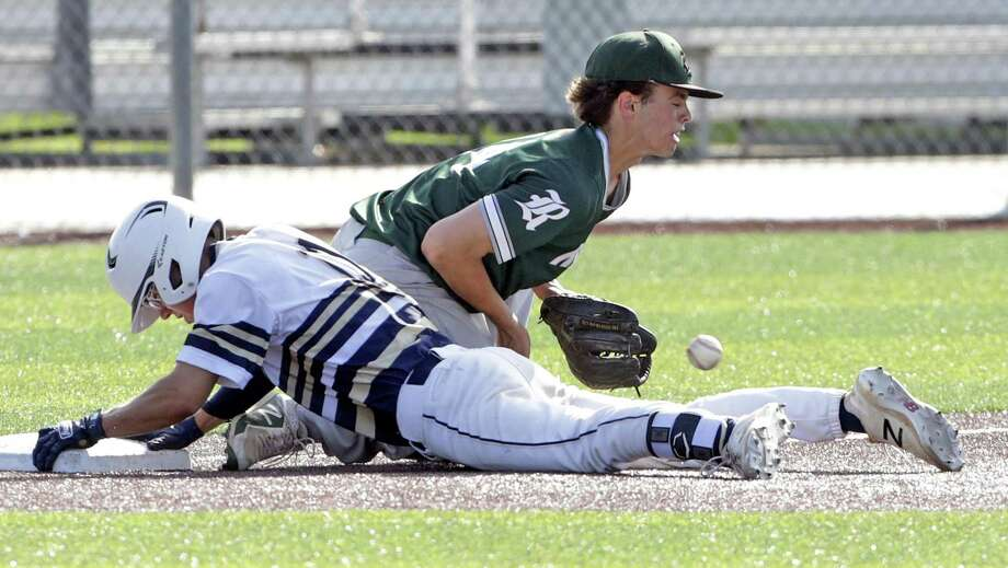Joel Hinojosa gets in safe for a one RBI triple in the second inning for the Bulldogs with Rattler third baseman Luke Hoggatt getting the ball late as Reagan plays Alexander in game 2 of the Class 6A Regional Semifinals at Cabaniss Field in Corpus Christi on May 24, 2019. Photo: Tom Reel, Staff / Staff Photographer / 2019 SAN ANTONIO EXPRESS-NEWS