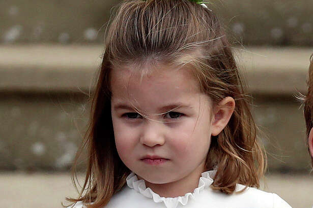 FILE - In this Friday, Oct. 12, 2018 file photo, Princess Charlotte arrives for the the wedding of Princess Eugenie of York and Jack Brooksbank at St George's Chapel, Windsor Castle, near London, England. The birth of a royal baby boy to Prince Harry and his wife Meghan, the Duchess of Sussex, has changed the line of succession with the baby becoming seventh in line of succession to the throne. (Steve Parsons/Pool via AP, File)