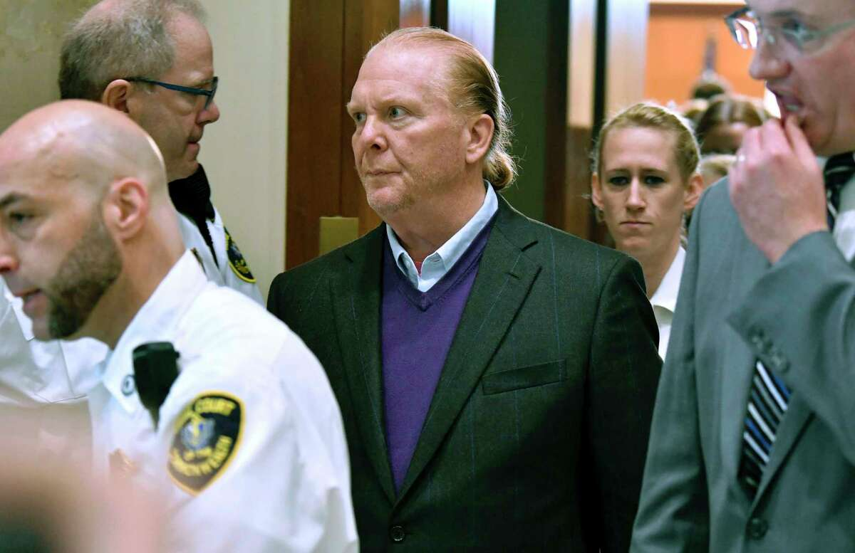 Chef Mario Batali departs after pleading not guilty, Friday, May 24, 2019, at municipal court in Boston, to charges he forcibly kissed and groped a woman at a Boston restaurant in 2017. (AP Photo/Josh Reynolds)