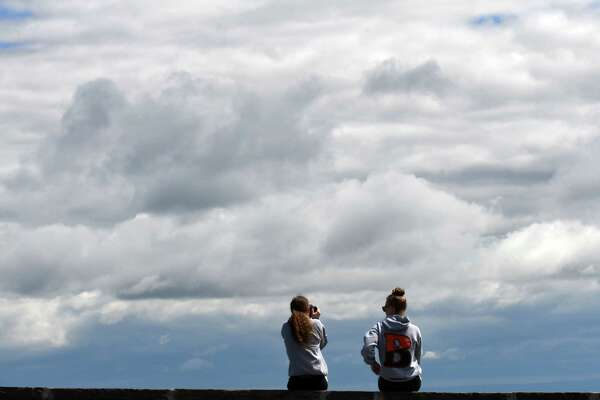 Sisters, Emily and Maggie Remmel of Bethlehem take in the view from the John Boyd Thacher State Park Overlook as an equally stunning could-scape fills the sky above on Friday, May 24, 2019, in New Scotland, N.Y. (Will Waldron/Times Union)