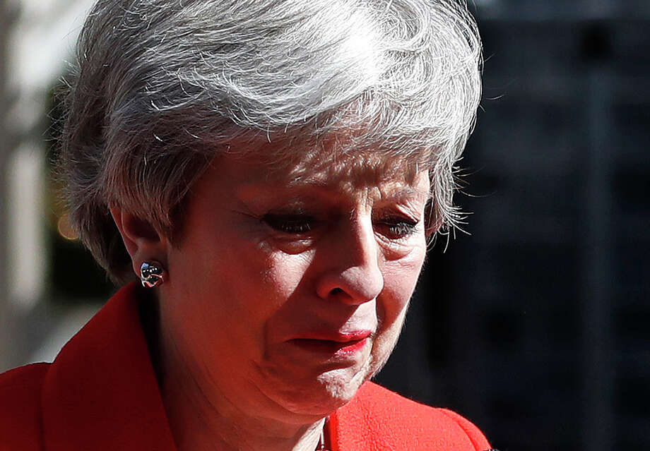 British Prime Minister Theresa May reacts as she turns away after making a speech in the street outside 10 Downing Street in London, England, Friday, May 24, 2019. Theresa May says she'll quit as UK Conservative leader on June 7, sparking contest for Britain's next prime minister. (AP Photo/Alastair Grant) Photo: Alastair Grant / Copyright 2019 The Associated Press. All rights reserved.