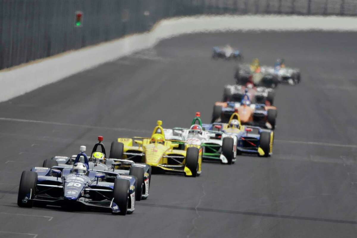 Ed Carpenter leads a group of cars into turn one during the final practice session for the Indianapolis 500 IndyCar auto race at Indianapolis Motor Speedway, Friday, May 24, 2019, in Indianapolis. (AP Photo/Darron Cummings)