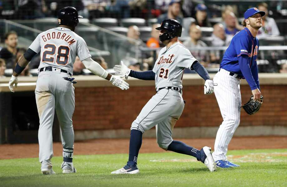Detroit Tigers on-deck batter Niko Goodrum (28) greets teammate JaCoby Jones (21) after Jones scored on Brandon Dixon's pinch-hit RBI-single during the seventh inning of a baseball game against the New York Mets, Friday, May 24, 2019, in New York. Mets relief pitcher Drew Gagnon, right, looks on. (AP Photo/Kathy Willens) Photo: Kathy Willens / Copyright 2019 The Associated Press. All rights reserved.
