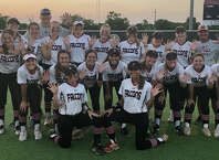 The Hargrave Lady Falcon softball team poses celebratorily after sweeping Lorena in the regional semifinals