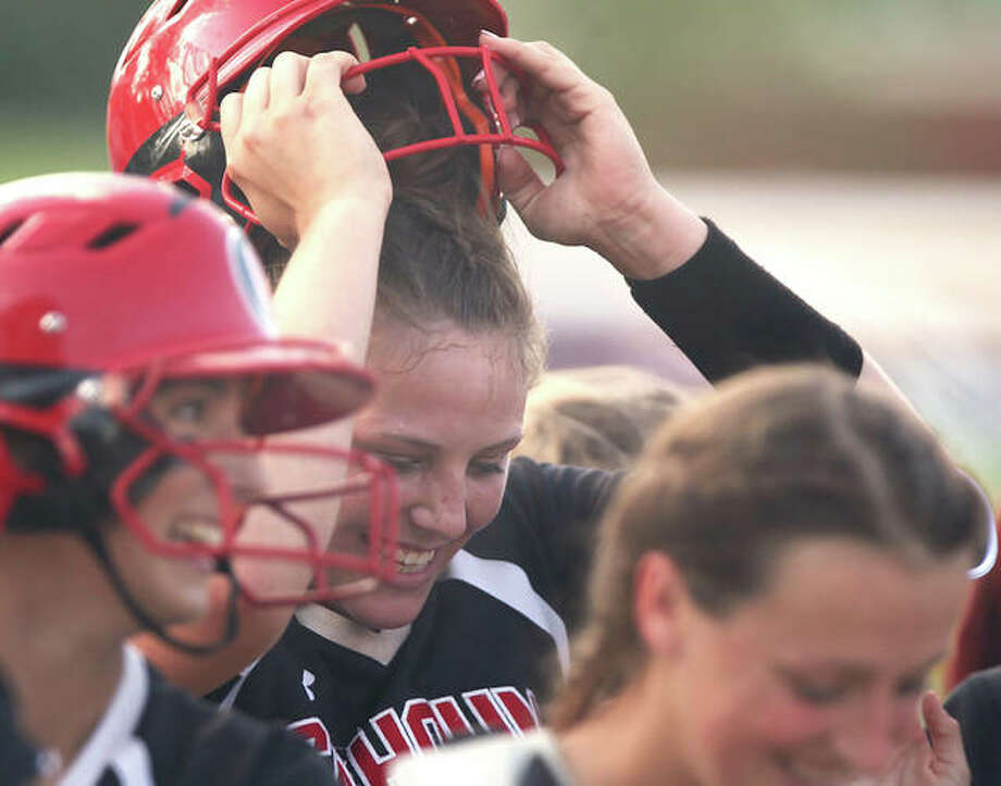 Calhoun's Sydney Baalman (middle) takes off her helmet after hitting at walk-off home run after pitching a one-hitter to give the Warriors a victory over Jacksonville Routt in a Class 1A sectional title game in Jacksonville. Photo: Dennis Mathes / Hearst Illinois