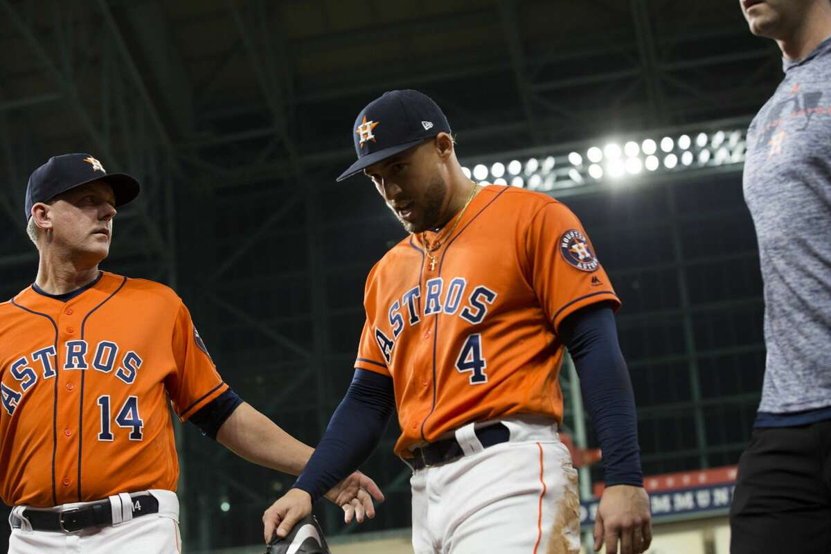 Houston Astros center fielder George Springer (4) returns to the dugout with an injury during a game against the Boston Red Sox on Friday, May 24, 2019, in Houston.