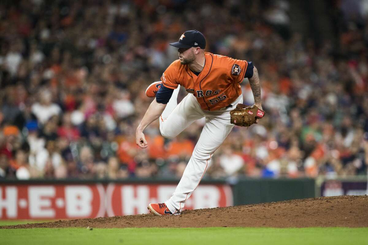 Houston Astros relief pitcher Ryan Pressly (55) pitches during the eighth inning against the Boston Red Sox on Friday, May 24, 2019, in Houston.