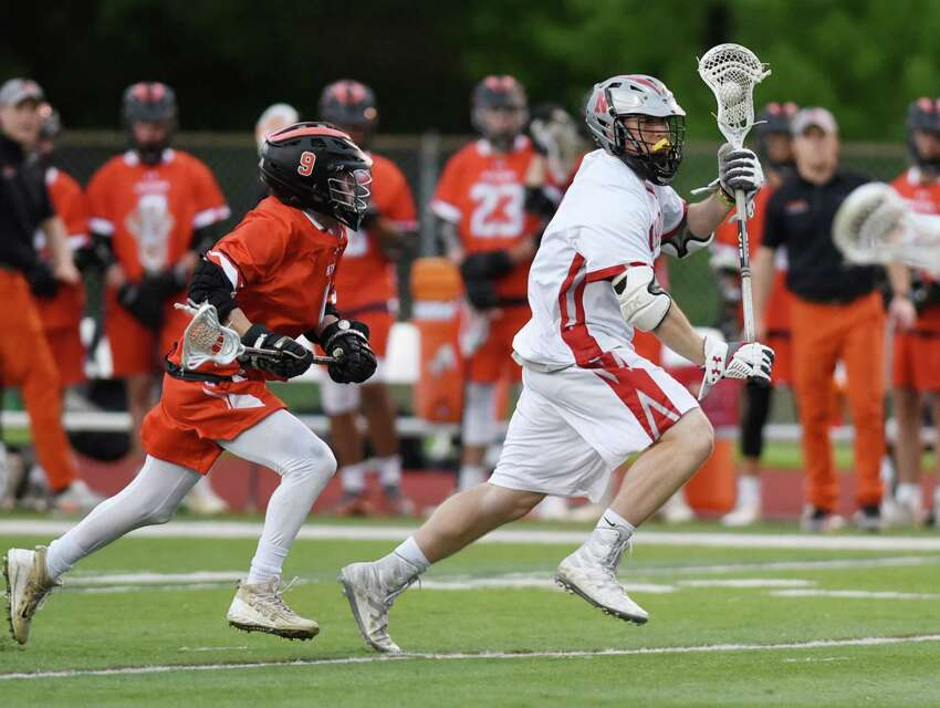 Niskayuna midfielder Gabe Nish runs down the field to score a goal during the Class A boys' lacrosse final on Friday, May 24, 2019 at Columbia High School in East Greenbush, NY. (Phoebe Sheehan/Times Union)