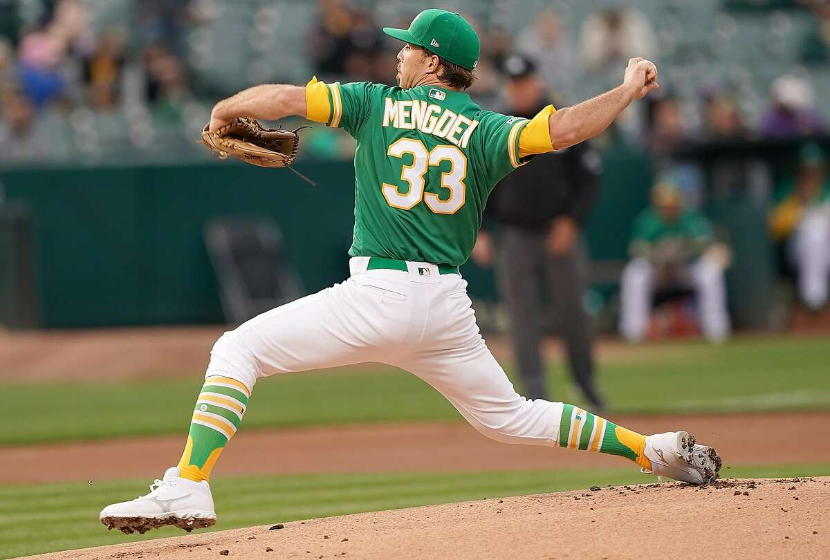 OAKLAND, CA - MAY 24: Daniel Mengden #33 of the Oakland Athletics pitches against the Seattle Mariners in the top of the first inning of a Major League Baseball game at Oakland-Alameda County Coliseum on May 24, 2019 in Oakland, California. (Photo by Thearon W. Henderson/Getty Images)