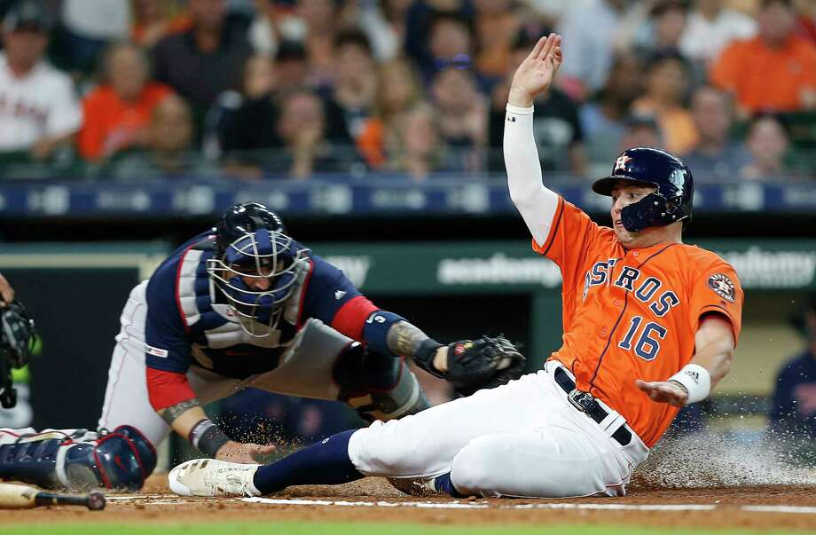 HOUSTON, TEXAS - MAY 24: Aledmys Diaz #16 of the Houston Astros scores as he avoids the tag attempt by Sandy Leon #3 of the Boston Red Sox in the second inning at Minute Maid Park on May 24, 2019 in Houston, Texas. (Photo by Bob Levey/Getty Images) Photo: Bob Levey / 2019 Getty Images
