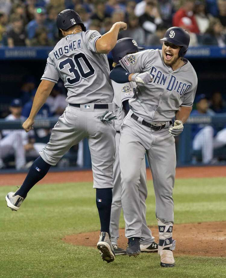San Diego Padres' Hunter Renfroe celebrates with Eric Hosmer after Renfroe hit a three-run home run against the Toronto Blue Jays during the eighth inning of a baseball game Friday, May 24, 2019, in Toronto. (Fred Thornhill/The Canadian Press via AP) Photo: Fred Thornhill / The Canadian Press