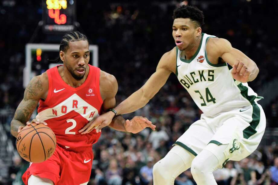 Toronto Raptors forward Kawhi Leonard (2) drives against Milwaukee Bucks forward Giannis Antetokounmpo (34) during the second half of Game 5 of the NBA basketball playoffs Eastern Conference finals in Milwaukee on Thursday, May 23, 2019. (Frank Gunn/The Canadian Press via AP) Photo: Frank Gunn / The Canadian Press