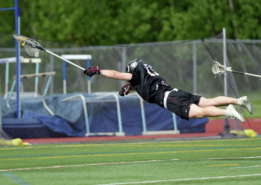 Burnt Hills goalie Chris Serafini dives in the air for the ball during the Class B boys' lacrosse final on Friday, May 24, 2019 at Columbia High School in East Greenbush, NY. (Phoebe Sheehan/Times Union)