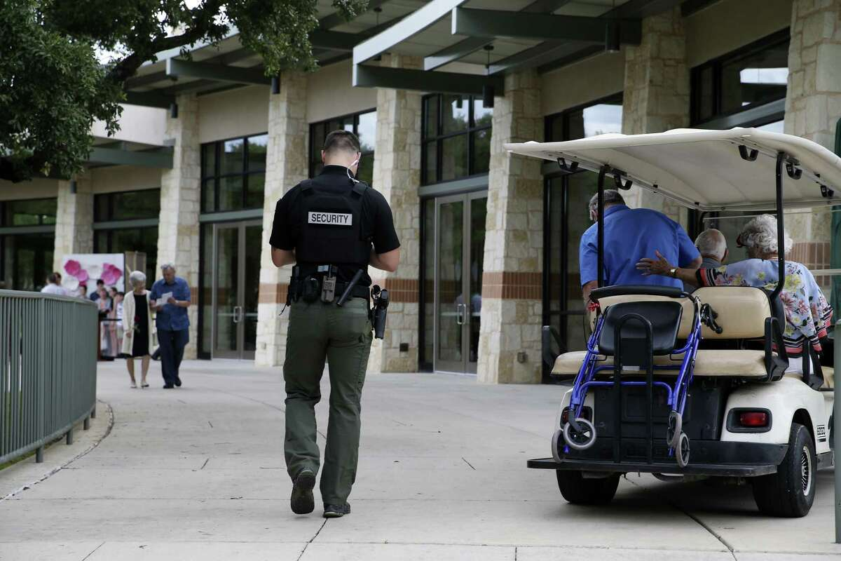 A uniformed security officer patrols the grounds of Concordia Lutheran Church, Sunday, May 12, 2019. The church uses a combination of plain-clothes and uniformed armed security to protect the congregation.