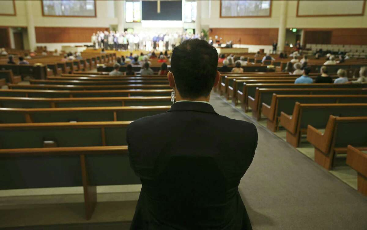 Plain-clothes security personnel keep an eye as congregation members during services sat Concordia Lutheran Church, Sunday, May 12, 2019. The church uses a combination of plain-clothes and uniformed armed security.