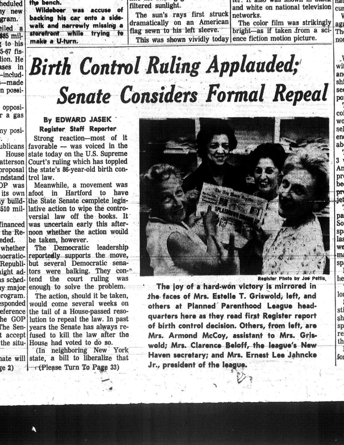 A clipping from the front page of the New Haven Register of June 8, 1965, shows Estelle Griswold, left, and Ernest Jahncke, president of the Planned Parenthood League of Connecticut, celebrating the Supreme Court's decision of Griswold v. Connecticut.