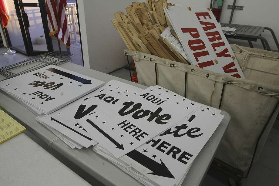 """Vote Here"" signs are seen at an early voting location. Photo: John Davenport, San Antonio Express-News"