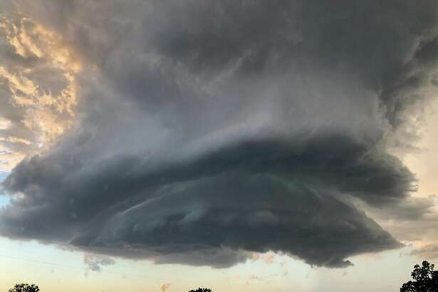 A tornado-like cloud formed on Highway 5 in Redding amid a tornado warning from the Sacramento office of the National Weather Service.