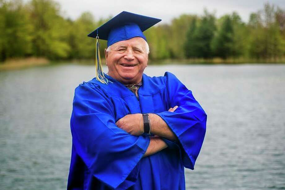 Midland resident Jimmey Sequin, 71, poses for a portrait on Wednesday at the pond on his property. Sequin enlisted in the Marine Corps at age 17, eventually serving in Vietnam. He will walk with the Midland High Class of 2019at its commencement ceremony. (Katy Kildee/kkildee@mdn.net)