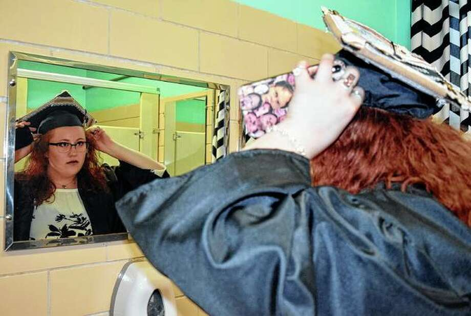 Hannah Marcel adjusts her graduation cap prior to Franklin High School's graduation ceremony Friday. Franklin's graduating class had 12 seniors. Photo: Samantha McDaniel-Ogletree | Journal-Courier
