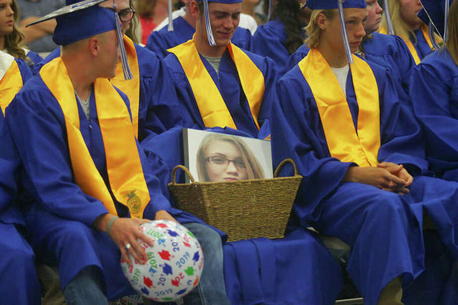 The North Greene High School class of 2019 saved a chair for Lesley Bricker, who died in 2017. North Greene graduated 55 seniors during a ceremony Friday evening. Photo: Rosalind Essig | Journal-Courier