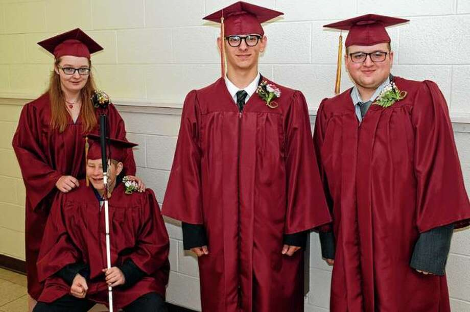 The four seniors at the Illinois School for the Visually Impaired gather in the hallway before their Friday graduation ceremony. Photo: David Blanchette | For The Journal-Courier