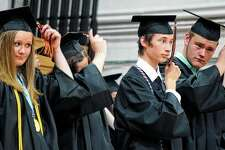 Waverly seniors turn their tassels Friday during their graduation ceremony.