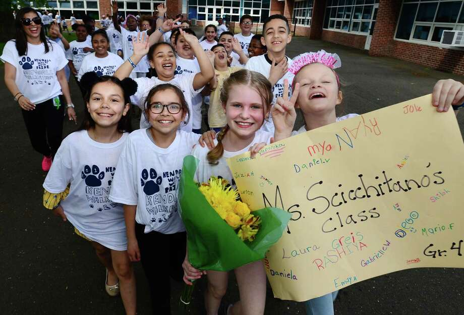 4th graders Stephanie Urena, Daniela Garcia, Ashlee DiPisa and Veronica Kravchuck, join their class during Kendall Elementary School 3rd annual walkathon Friday, May 24, 2019, in Norwalk, Conn. Organized by the PTA, students have been raised $15,00o since April for school improvements and enrichment programs. Photo: Erik Trautmann / Hearst Connecticut Media / Norwalk Hour